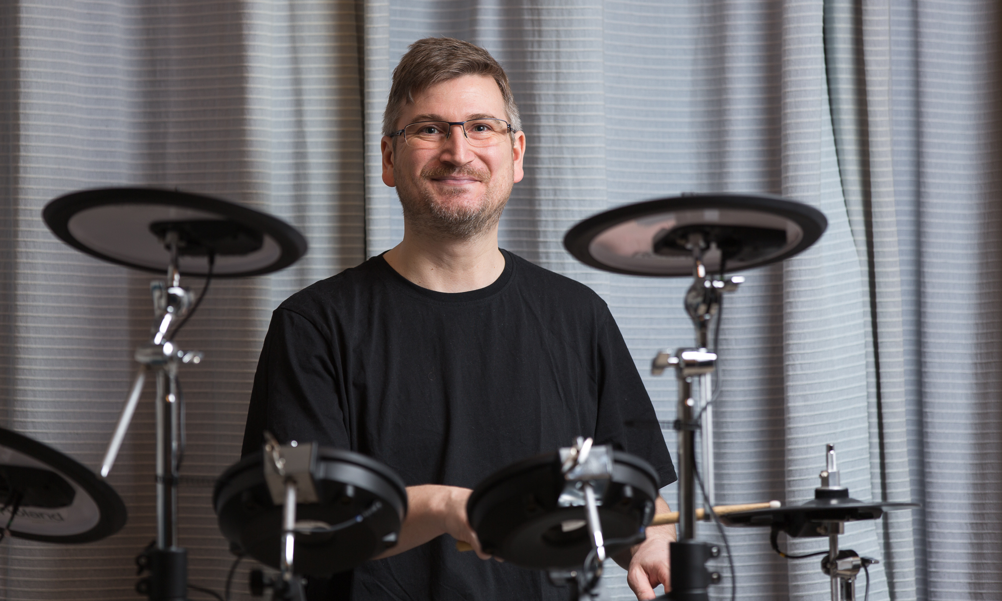 Drum Teacher Matthew Johns, playing a Roland Electronic Drumkit