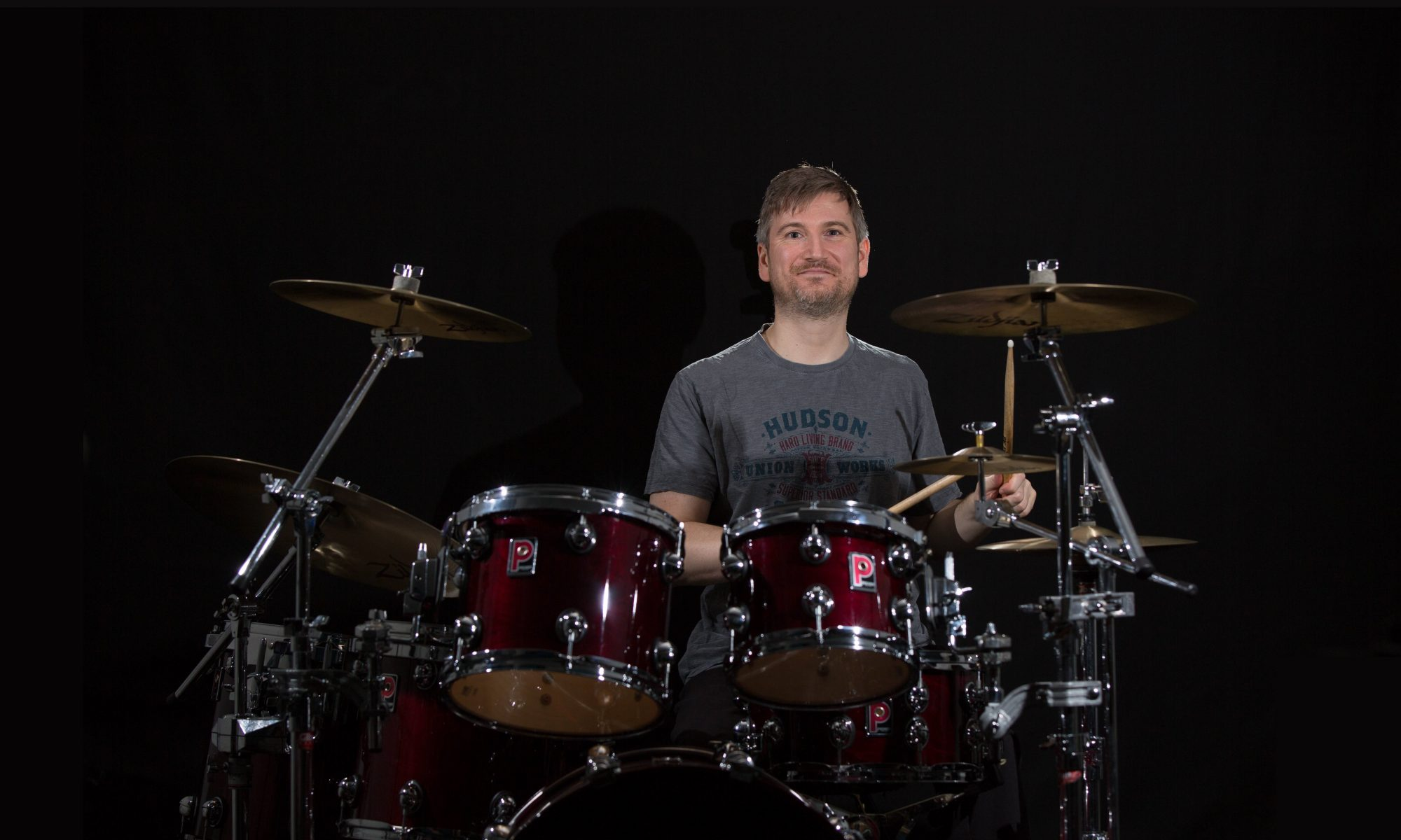 Drum Teacher Matthew Johns playing a Premier Genista drumkit.