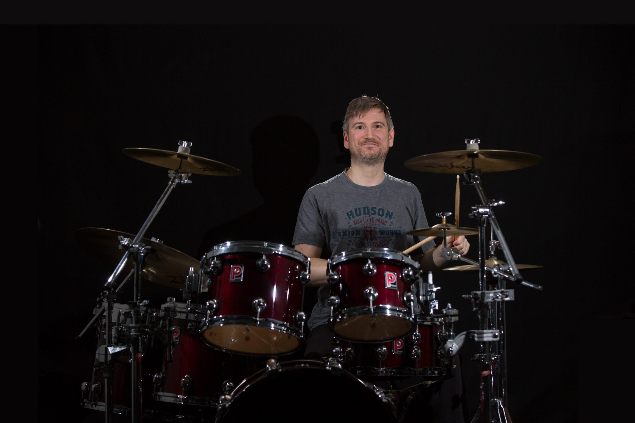 Drum Teacher Matthew Johns playing a Premier Genista drumkit.
